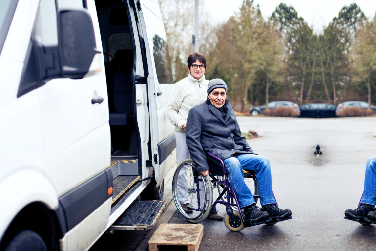 medical staff assisting patient in wheelchair